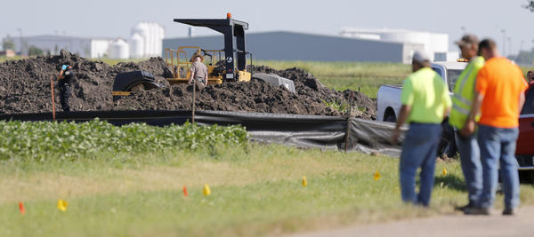 Aberdeen Police and South Dakota Highway Patrol officers work the scene of a fatal accident in the Aberdeen Industrial Park Tuesday around 5 p.m. photo by john davis taken 7/23/2013
