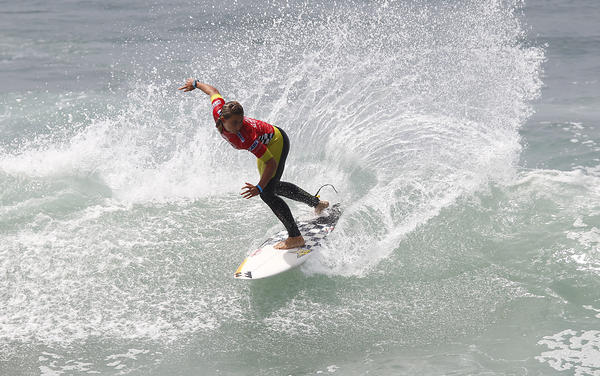 Courtney Conlogue rips a backhand snap as she surfs in Round 1 of the women's division of the 2013 Vans US Open of Surfing at the Huntington Beach Pier on Tuesday.