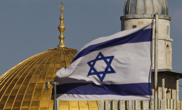 An Israeli flag flies near the Dome of the Rock Mosque in Jerusalem's Old City. Israel considers the city its political and spiritual capital, while Palestinians seek to make East Jerusalem the capital of a future country.