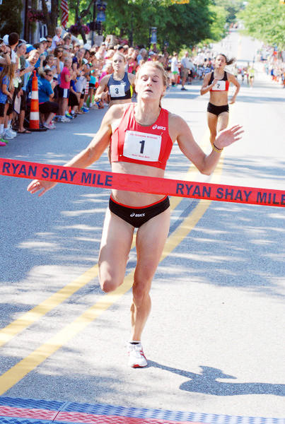 Heather Kampf of Inver Grove Heights,Minn.crosses the finish line to win the womens race at the 2012 Ryan Shay Mile in Charlevoix. Kampf finished in a womens course record time of 4 minutes, 31.83 seconds.