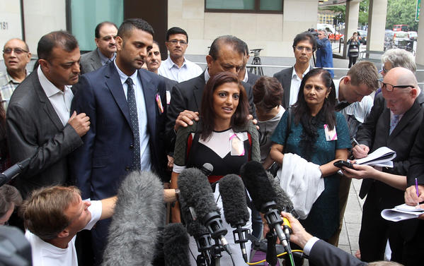 Surrounded by family members, Ami Denborg, sister of Anni Dewani, speaks to reporters outside Westminster Magistrates Court in London on Wednesday.