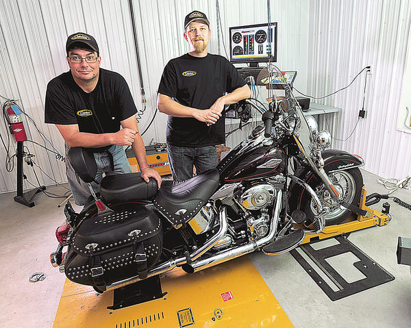 Jeffrey Katusin, left, and Anthony McIntyre opened Caledonia Power Sports on April 1 at 6210 Chambersburg Road in Fayetteville, Pa. Among the business' offerings are motorcycle repair and service, state inspections, tires, brakes and performance upgrades.