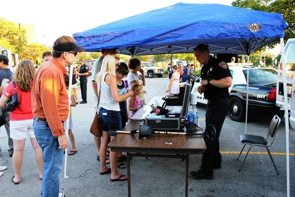 Des Plaines police officers interact with residents at last year's National Night Out festivities.
