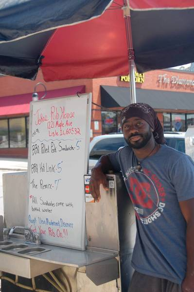 John Singleton Jr. is one of two vendors with a permit to operate a food cart in downtown Naperville.