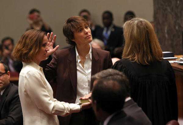 Deb Mell is sworn into the Chicago City Council as Alderman of the 33rd ward as her wife Christin Baker holds the Bible.