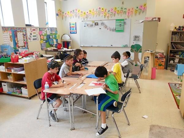 Kids work in kindergarten and first grade in Morah Mindy Cohen's class at the Torah Academy in Buffalo Grove when it was located at Beth Am Temple.