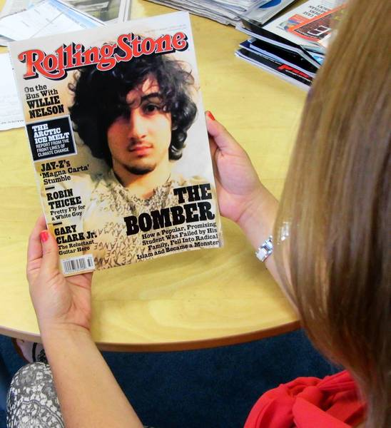 "An early copy of Rolling Stone magazine's August 2013 issue is read at an office in Los Angeles on July 17, 2013. Rolling Stone defended the cover story on Boston bombing suspect Dzhokhar Tsarnaev, which triggered criticism that the magazine was ""glamorizing terrorism"" and calls to boycott the publication."
