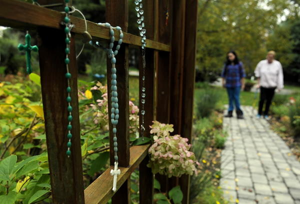Rosaries and keepsakes are displayed at the memorial garden on the site of the former Petit home in Cheshire, the site of the horrific 2007 slayings of Jennifer Hawke-Petit and her daughters, Hayley and Michaela.