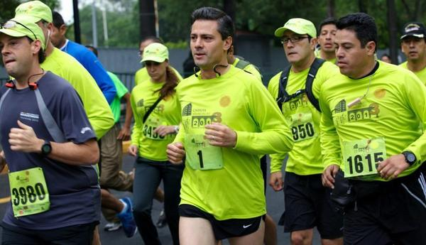 A handout photograph made available by Mexican Presidency on 13 July 2013 shows President of Mexico, Enrique Pena Nieto (C), as he runs at 3rd 'Molino del Rey' 10k-race in Chapultepec Park, Mexico City, Mexico.