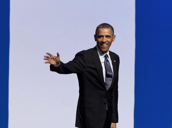 President Obama waves after his speech at the Jerusalem International Convention Center.