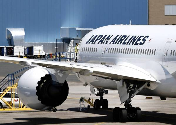 A Japan Airlines Boeing 787 aircraft sits on the tarmac at Logan International Airport after it returned to Boston because of a possible fuel pump issue. It's the latest trouble for the new Dreamliner aircraft after a lithium-ion battery problem grounded the fleet in January.