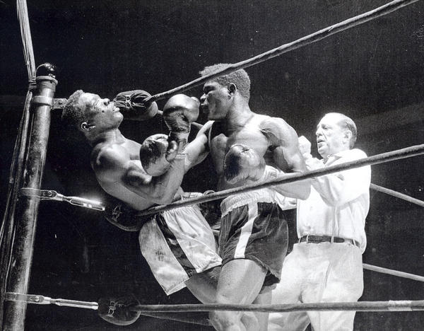 """Emile Griffith delivers a crushing blow to Benny """"Kid"""" Paret in their famed 1962 bout in Madison Square Garden. Paret died 10 days later."""