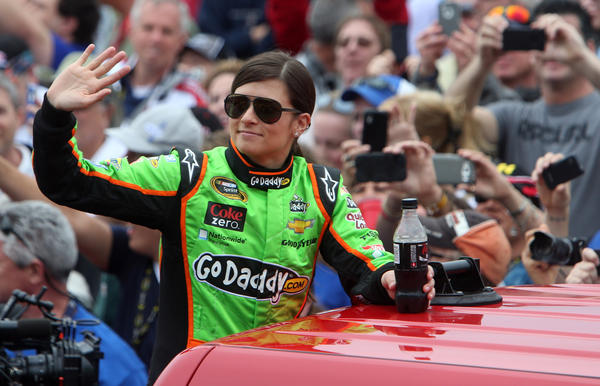 Feb 24, 2013; Daytona Beach, FL, USA; NASCAR Sprint Cup Series driver Danica Patrick waves to the crowd as she is introduced before the 2013 Daytona 500 at Daytona International Speedway.