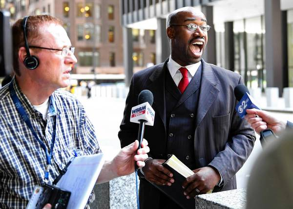 Bishop Herman Jackson, of Ark of Safety Apostolic Faith Temple in Cicero, talks with reporters outside the Dirksen U.S. Courthouse after Wednesday's court hearing.