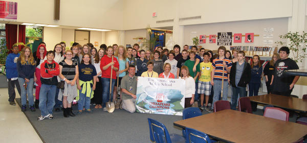 Waynesboro Area Middle School is now a National Geographic PA Chesapeake Champion school. WAMS middle school teachers, Tawyna Finney, Bryan Flickinger, Lori Schlosser and Kristin Zaruba celebrate with their students during a recent banner presentation at the school.