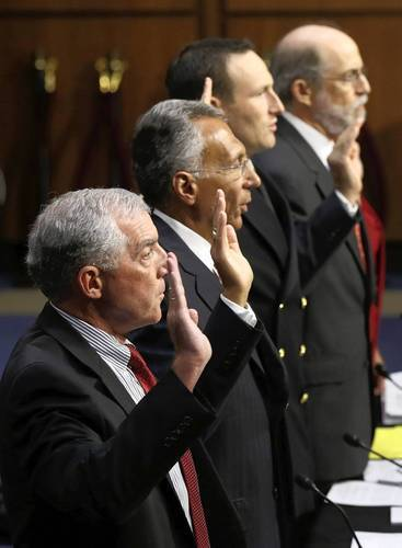 Retired Army Maj. Gen. Paul Eaton, left; retired Army Brig. Gen. Stephen Xenakis; Navy Lt. Joshua Fryday; and Frank Gaffney, founder and president of the Center for Security Policy; prepare to testify at a Senate subcommittee hearing on the Guantanamo Bay prison.