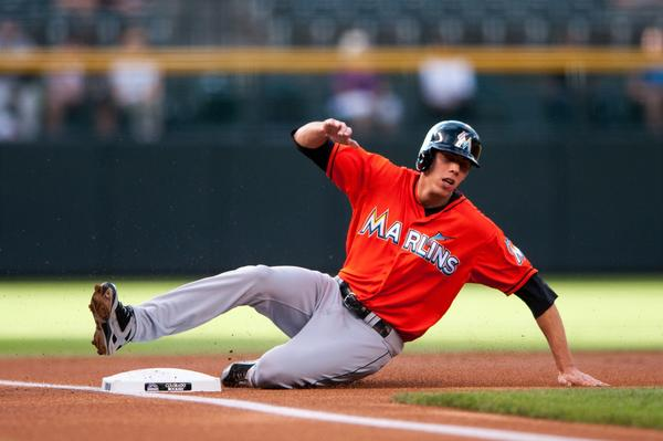 DENVER, CO - JULY 24: Christian Yelich #21 of the Miami Marlins slides safely into third base on a single by Placido Polanco #30 (not pictured) in the first inning of a game against the Colorado Rockies at Coors Field on July 24, 2013 in Denver, Colorado. (Photo by Dustin Bradford/Getty Images) ORG XMIT: 163494674