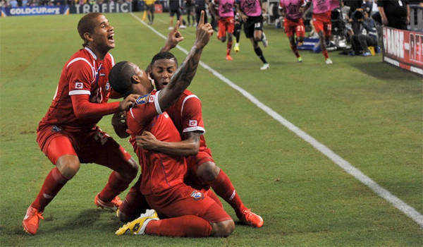Roman Torres, center, Roberto Chen, left and Gabriel Torres celebrate after scoring against Mexico during Panama's 2-1 victory to advance to the Gold Cup final against the United States.