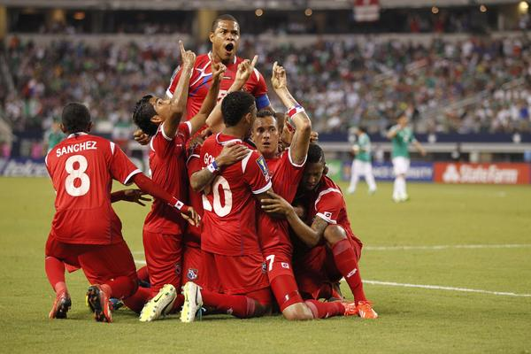 Panama player Blas Perez celebrates scoring a goal with his teammates during the first half of the game against Mexico at Cowboys Stadium.