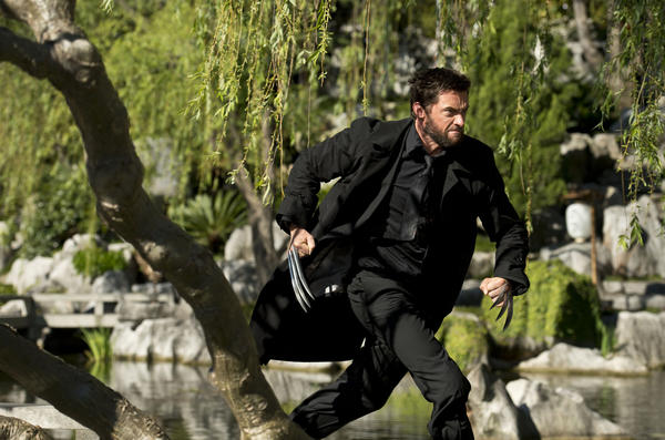 Logan (Hugh Jackman) races into a battle that's shattered a sacred ceremony. Photo credit: Ben Rothstein.
