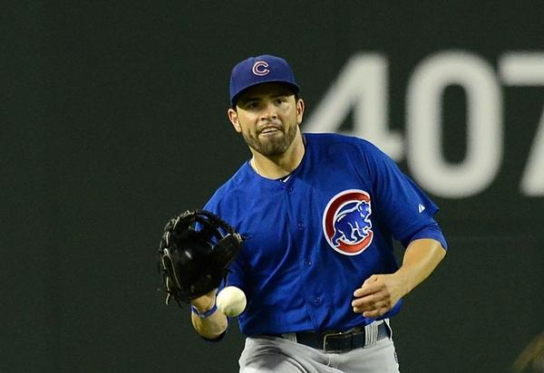 Cubs' David Dejesus makes a play on a bouncing ball in center field against the Diamondbacks.