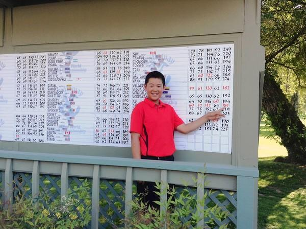 Alexander Yang, 10, points to his score after winning the Callaway Junior World Golf Championships.