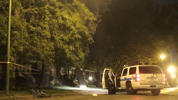Police guard a crime scene in the 6900 block of South Michigan Avenue in the Park Manor neighborhood.
