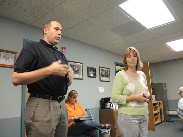 Todd Fewins, engineering manager for Boyne City's Precision Edge Surgical Products Company (left) and Sara Christensen, economic development specialist with the Northern Lakes Economic Alliance, speak to the Charlevoix County Board of Commissioners at its regular meeting Wednesday.