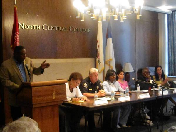 Juan Thomas, left, political action chair of the DuPage NAACP, moderates an NAACP town hall meeting featuring panelists Dr. Lourdes Ferrer, an educational consultant; Naperville police Deputy Chief John Gustin; NAACP national board member the Rev. Theresa Dear; Maryam Judar, executive director of Citizen Advocacy Center; Dr. Renard Jackson, director of outreach and program development at North Central College; and state Rep. Linda Chapa LaVia.