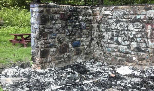 Vandals burned the roof and benches on this shelter in Bethlehem along the Lehigh River. Picnic benches that volunteers built and installed will be removed, the walls knocked down and the site abandoned to nature.