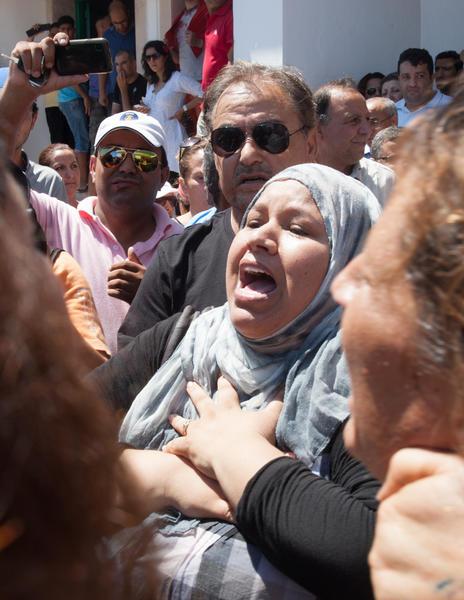 A Tunisian reacts outside Mahmoud Materi hospital Thursday following the death of opposition politician Mohammed Brahmi.