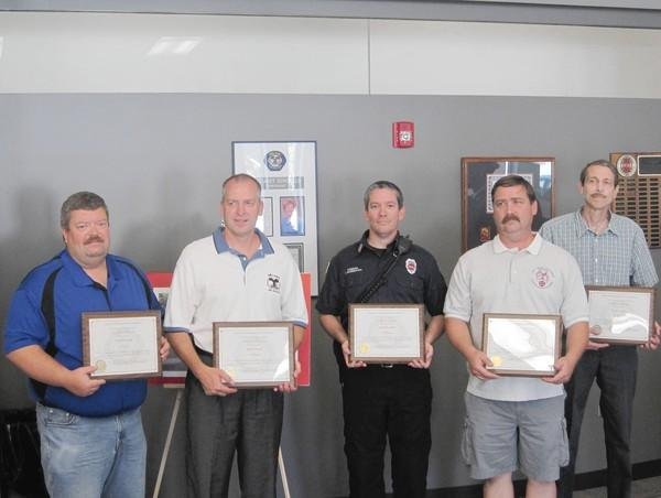 From left, Robert Murphy, Michael Srncik, Joseph Mandekich, Edward Dunne and Terry Campagne. (Not pictured: Pamela Exline). All six were recognized for their 20 years of service to the Orland Fire Protection District July 23,