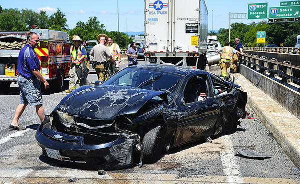 Police and rescue personnel work the scene of seven-vehicle incident Thursday on the Interstate 70 bridge over Interstate 81.