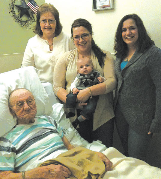 Clockwise from front, Paul R. Cartee, great-great grandfather; Debbie Myers, great-grandmother; Alyssa Beattie, great-granddaughter, holding Hudson Jude Spoonire; and Cristy Swiger, granddaughter.