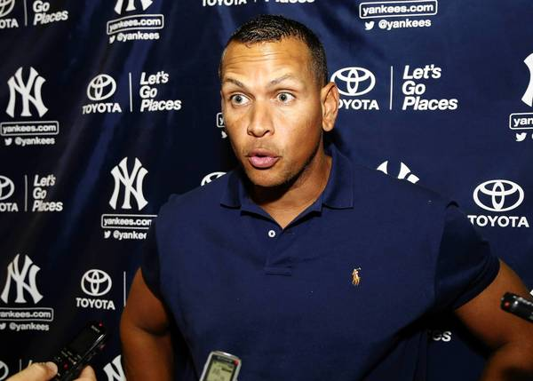 New York Yankees' Alex Rodriguez speaks with reporters following his rehab assignment for the Tampa Yankees in a minor league baseball game against the Bradenton Marauders in Tampa, Florida July 13, 2013.