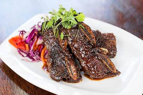 The beef short ribs are cooked in a cherry-hoison sauce.