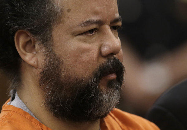 Ariel Castro stands before a judge during his arraignment on an expanded 977-count indictment in Cleveland. Castro is charged with kidnapping and raping three women over a decade in his home.