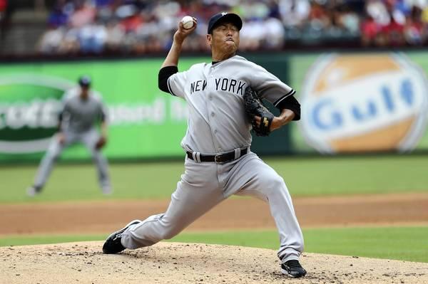 Hiroki Kuroda #18 of the New York Yankees pitches against the Texas Rangers on July 25, 2013 at the Rangers Ballpark in Arlington in Arlington, Texas.