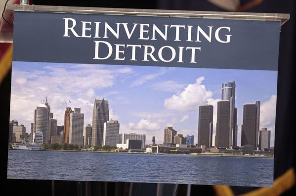 A image of the Detroit skyline is seen on the podium where Detroit Emergency Manager Kevyn Orr and Michigan Governor Rick Snyder will address the media about filing bankruptcy for the city of Detroit during a news conference in Detroit, Michigan July 19, 2013.