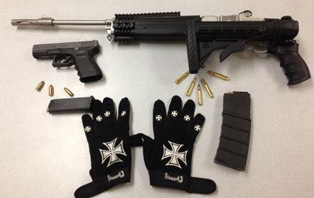 Some of the weapons and clothing recovered from the scene of an armed robbery in the Fort Lauderdale area.