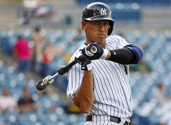 Yankees' Alex Rodriguez waits on deck while playing for the Tampa Yankees during the sixth inning of a minor league game.