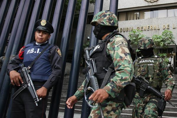 Mexican soldiers guard the building where Miguel Angel Trevio Morales, alias Z-40, is being held. The Mexican government arrested Morales in their fight against drug trafficking.