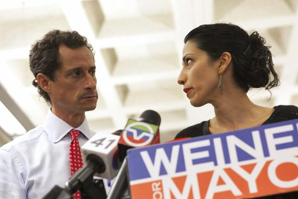 New York mayoral candidate Anthony Weiner and his wife, Huma Abedin, attend a news conference in New York on July 23.