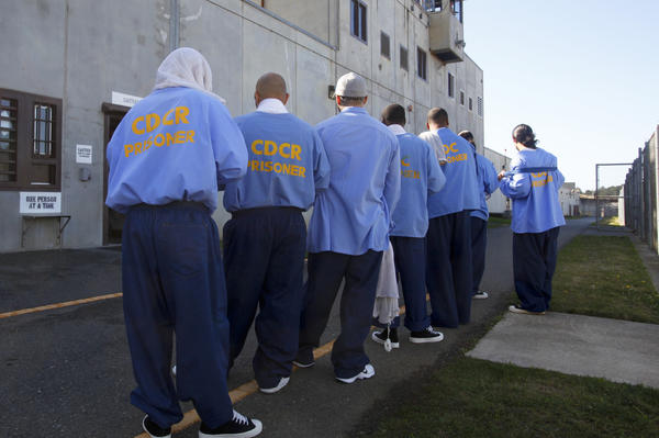 Pelican Bay State Prison inmates stand in the yard during an exercise period in Crescent City, Calif.