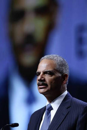 Atty. Gen. Eric H. Holder Jr. said the Justice Department would seek to require Texas to submit all proposed voting-law changes to Washington for advance approval.