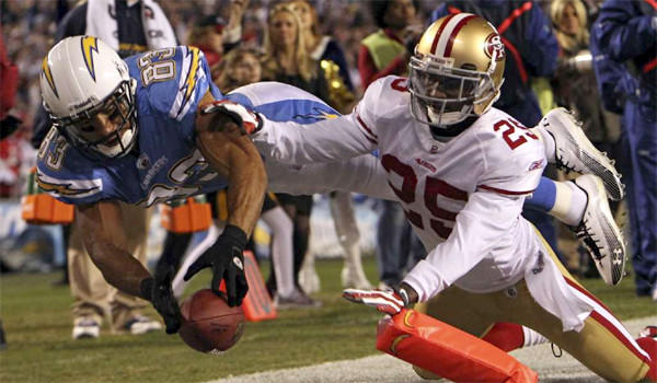 San Francisco 49ers cornerback Tarell Brown is unable to stop Chargers wide receiver Vincent Jackson from finding pay dirt on Dec. 16, 2010.