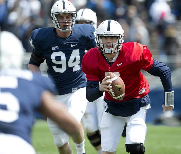 Penn State quarterback Tyler Ferguson (5) scrambles in Penn State's annual Blue-White game at Beaver Stadium in University Park on Saturday April 20, 2013.