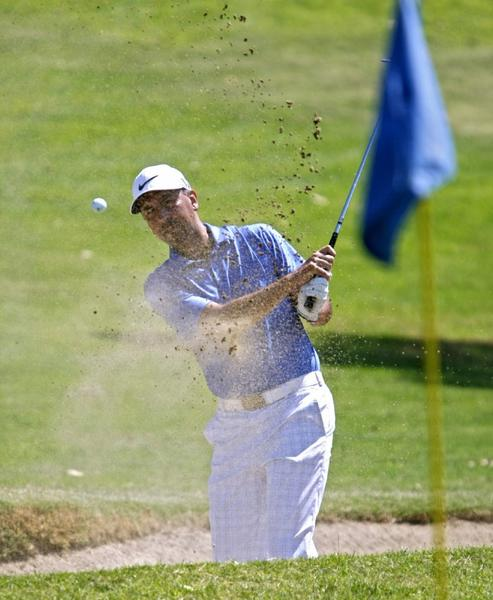 Se Chavez of Altadena shoots out of a sand trap during the Glendale City Golf Championship at Scholl Canyon Golf Course.