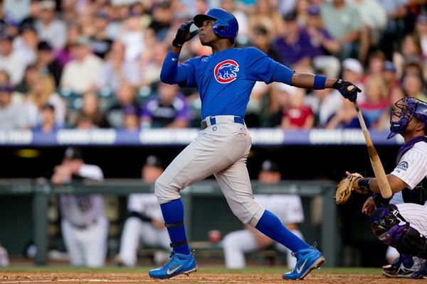 Cubs' Alfonso Soriano hits a solo home run in the fourth inning against the Rockies.