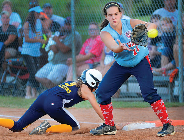 Halfway first baseman Morgan Domer (17) awaits the pickoff throw while Perryville runner Ashley Meekins scrambles back to the bag during Thursday's fourth inning of the Maryland State Junior Softball Tournament's championship game. Perryville won 2-1.